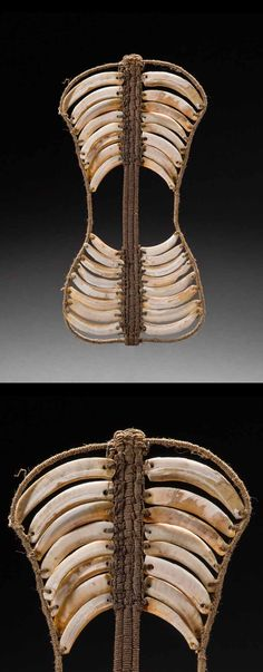 Papua New Guinea - South Coast   Pectoral from the Motu people; boar's tusks and natural fiber.  H:  28 cm    ca. late 19th century   3200$