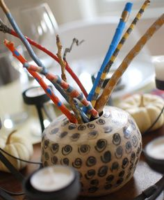 Painted Stick Centerpiece. Add this festive decoration to your table.