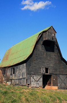 Old barn with green roof by roxie