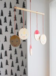 Adorable mobile, from the whimsical wallpaper room.