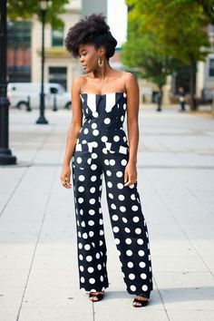 Shop this look on Lookastic: https://lookastic.com/women/looks/black-and-white-polka-dot-jumpsuit-black-leather-heeled-sandals/12541   — Black and White Polka Dot Jumpsuit  — Black Leather Heeled Sandals