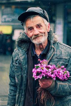 A man and his flowers. They say, where flower blooms, so does hope... That's exactly what his tired eyes seems to say. Deep from my heart, I'm wishing you well, sir... ~ Zeta M Mood