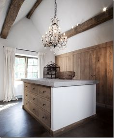 Concrete topped island in dressing room of Belgian country home