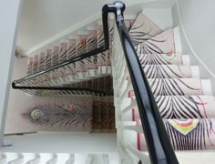 Custom runner of Matthew Williamson's wool and silk Peacock Light design. The runner stretched over 4 flights of stairs and two landings in a London townhouse.