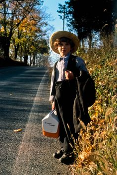 An Amish boy on his way home from school.