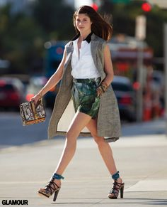 Style tip from our March issue: dress up some outfit-making shorts with a tailored sleeveless jacket. Photo: Hans Feurer. Jacket, shirt, shorts, Dries Van Noten; bangles, Kora; bag, Angel Jackson; shoes, BCBG Max Azria.