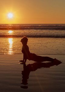 My wife in upward facing dog on Pacific Beach CA