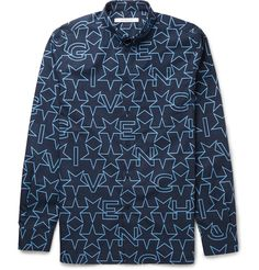 Graphic star prints have become a Givenchy trademark and this shirt features the stellar motif interspersed with lettering for a striking effect. The navy and light-blue colour palette will add character to your solid-tone separates, while a slim Cuban fit gives the design a sleek, modern feel.