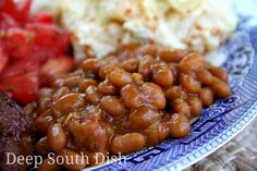Southern Style Baked Beans - Southern seasoned baked beans with chili sauce, mustard, brown sugar, bacon, onion and bell pepper - they're a cookout tradition! Pictured here with grilled ribs, Mama's Southern potato salad and marinated tomatoes.