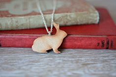 Wooden Rabbit Necklace. A delightful handmade rabbit necklace, with silver plated chain and findings.  https://www.etsy.com/uk/listing/222293205/wooden-rabbit-necklace-woodland-animal