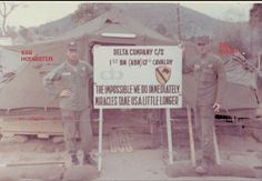 """This was the Delta Company headquarters tent, set up soon after arrival at An Khe.  Here we see SSG Hofmister and Sgt Oyler holding the sign the first day it adorned the company area.""  D Company 1/12th Cavalry Vietnam"