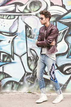 Men's burgundy leather jacket from DSQUARED and embroidered denim jeans from NSF x Bliss and Mischief #graffiti #talunzeitoun