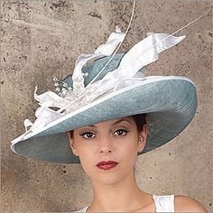 • Tennis   • Design by Vivien Sheriff   • Sinamay Base, Silk Sash and Trim, Swarovski Crystals, Ostrich Quills  • Colors: Aqua and White  • Size: Fits Most  • Handmade in the UK  • Vivien Sheriff is a renowned designer from England. Her hats have fitted the heads of British royals and are now available to you through HATagories.