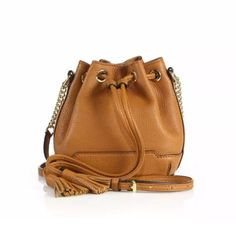 """HP Rebeca minkoff mini Lexi bucket bag Brand new with tag! Authentic!  Come with original dust bag!  ❌trade❌ •Petite bucket design with sleek chain strap •Chain-and-leather crossbody strap, 23.5"""" drop •Drawstring closure •Goldtone hardware •One inside open pocket •Fully lined •Includes dust bag •5.75""""W X 6""""H X 4.25""""D •Leather •Imported Rebecca Minkoff Bags Crossbody Bags"""