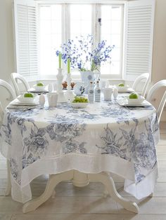 Something like this used as a topper with a navy blue or white tablecloth underneath that's to the floor. Linen Tablecloth - Blue Vintage Rose from Nordic House