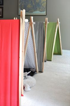 DIY A-frame tents....ooooh, I want to do this, love that they fold away.... Looks like these ones have dowels at the bottom, too, to hold the fabric in place. That will be MUCH better than the one I made!