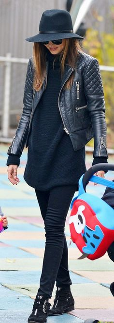 Miranda Kerr's black sweater dress, black hat, black leather jacket, and black triple buckle boots that she wore in New York