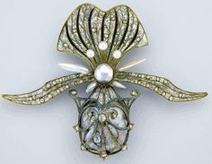 French Art Nouveau orchid brooch ca 1901 by Georges (1862–1957),in gold, enamel, diamond and pearls. Museum of Fine Arts, Boston, lent by a private collection.