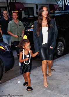 A new twist on an old look: Kim Kardashian wore leather shorts as she took daughter North ...