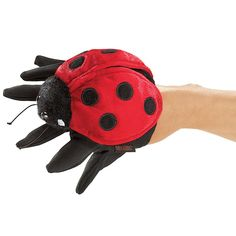 "<p><strong style=""line-height: 20.8px;"">RETIRED - This item was retired in July 2017 and has limited to no availability. </strong></p> <p>Ladybug, ladybug, how does your garden grow? No childhood is complete without these colorful polka dotted stewards of the garden! This Folkmanis LADYBUG glove puppet fits growing hands of all sizes, from child to adult. Innovative six fingered design may be worn on either hand. LADYBUG PUPPET includes ..."