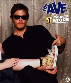The Walking Dead's Norman Reedus posing with Zombie Hunter shoes!