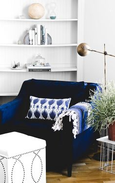 navy chair, white walls