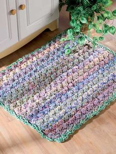 Puff Stitch crochet mat/rug will make it soft underfoot, and it's worked with triple strand worsted yarn and large hook so it would be very quick to make, too.