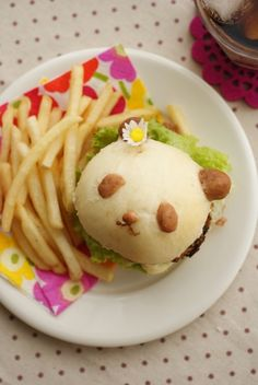 panda burger.  Don't know how it's done...mold the dough, steam instead of bake, use a torch to brown the designs.  Wonder if there is an easier way.