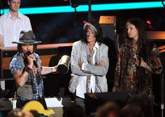Actor/musician Johnny Depp accepts the MTV Generation Award from musicians Steven Tyler and Joe Perry onstage during the 2012 MTV Movie Awards held at Gibson Amphitheatre on June 3, 2012 in Universal City, California.