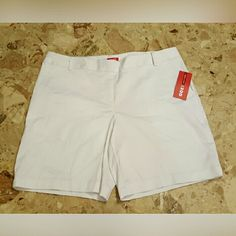 Izod Shorts Size 10 Stretch Izod Shorts Size 10 Stretch  Solid White NWT 2 pocket front & 1 faux pocket in the back.  97% cotton  3% spandex. Feel free to ask any questions before purchasing. Thanks for shopping my closet! IZOD Shorts