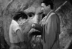 AudreyHepburn and Gregory Peck at the Bocca della Verita (Mouth of Truth) in Rome Italy - photo from from 'Roman Holiday' movie