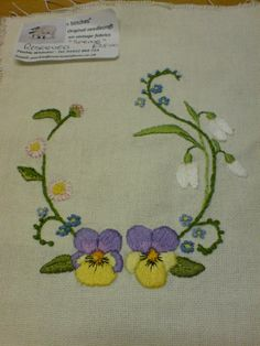 A spring flower design comprising viola, forget-me-not, snowdrop and daisy