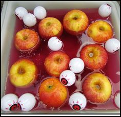 Bobbing for apples - a bit of red food coloring and eyeballs - great for a kids halloween party!