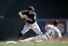 Brent Lillibridge #1 of the Cleveland Indians is out at second base as Brian Dozier #20 of the Minnesota Twins looks to turn a double play during the eighth inning on July 29, 2012 at Target Field in Minneapolis, Minnesota. The Twins defeated the Indians 5-1