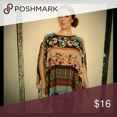 """Plus size Poncho top Shirt tunic Brown blue orange. Asymmetrical hem. Comfy soft material. Loose fit. 1x can fit 2x and so on. 28"""" from top to bottom in middle. Canari Tops Tunics"""