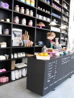Bonton | Paris awesome counter store front (Great idea for the large coutertop piece you have, a chalk board facing)