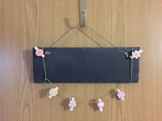 A chalk board photo holder! I'll give the as a present to my sister, maybe chalk 'memories' onto the board and then attach nice photos to each of the pegs. A cheap but very pretty present!
