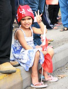 A child carrying a Bahrain flag and showing the victory sign during a pro-democracy rally. [click on this image for an award winning, short documentary and analysis of the recent uprising in Bahrain]