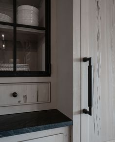 Our gray-washed Pecky Cypress paneling gives this kitchen a gentle and serene feel. Even when it's filled with our clients' many grandchildren it still (magically!) exudes peace. #paneling Commercial Interior Design, Commercial Interiors, Pecky Cypress Paneling, Reclaimed Wood Paneling, Grey Wash, Grandchildren, Door Handles, Peace, Gray