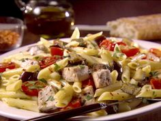 Sicilian Penne with Swordfish and Eggplant recipe from Giada De Laurentiis. Cook in wok, 2 med eggplants in small cubes, use 4 pieces of fish so maybe double wine, add fresh parsley, add tomatoes earlier to cook or omit