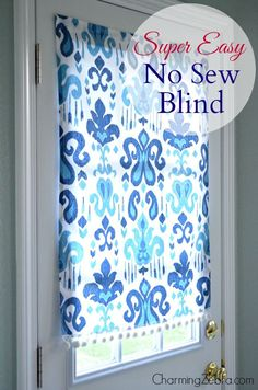 How to Make a No-Sew Magnetic Window Blind - tutorial shows how to make a fabric blind for a metal door using fabric, glue, trim and magnets. This is the easiest way to hang a curtain on a metal door - Charming Zebra, via Remodelaholic Door Window Covering, Curtain For Door Window, Door Curtains, Magnetic Blinds, Magnetic Curtain, Blinds For Windows, Windows And Doors, Window Blinds, Blinds Diy