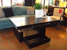 coffee table that makes into a dining table! with tons of storage...oooo