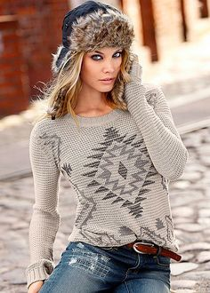 Be cold-weather ready in trendy tribal! Venus pattern crew neck sweater.