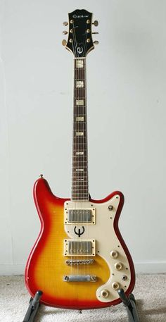 Epiphone Crestwood. My guitar in Jr High. Had the exact finish/color.
