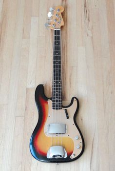 1959 Fender Precision Bass Pre CBS Vintage Electric Bass Guitar Sunburst w OHC.  $6,299.99 on eBay!