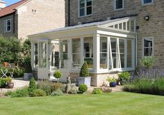 Pretty lean-to style timber conservatory | by DavidSalisburyConservatories