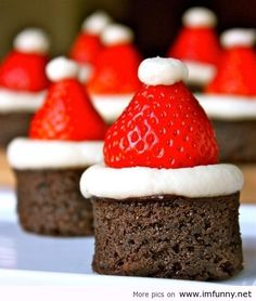 cute idea for xmas. use a biscuit cutter to cut the brownies and either white frosting, a melted marshmallow or cool whip with the strawberries. too cute