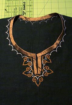 Embroidered Collar on tunic, with what looks like silk ribbon or bias around the collar, which is consistent with period finds