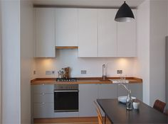 SQ1 Utilitarian Kitchen Chic - Oak, Formica & Corian