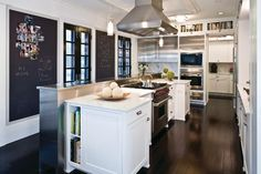 White and stainless kitchen with chalkboards; Nice to have big chalk board With magnetic Paint on left Side kitchen wall!